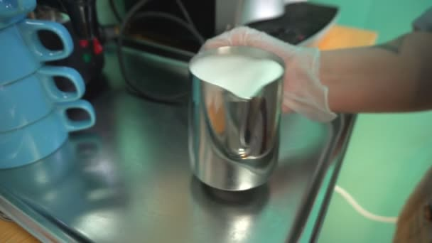 Female hand shake milk for coffee