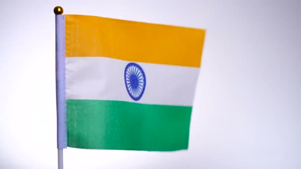 Indian flag on flagpole flying and waving in the wind.