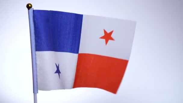 Flag of Panama on flagpole flying and waving in the wind.