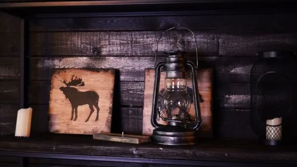 Retro interior design inside a bar. Outdated vintage objects. Kerosene lamp, pictures, candles