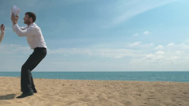 Office worker on the beach tries to sign business papers
