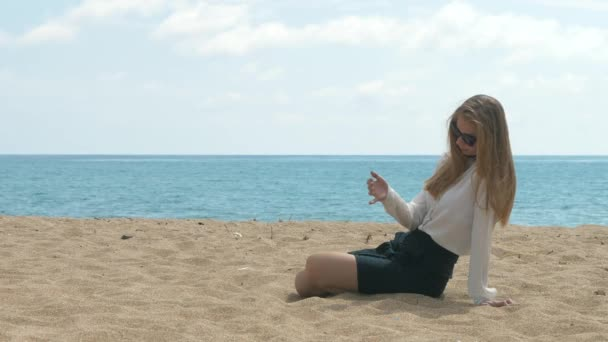 Young girl office worker on the beach