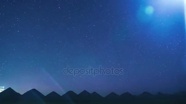 Stars Time Lapse of operating mine at night. Barkhan dumps similar to the Egyptian pyramids