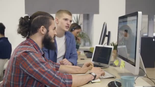Group of creative people working with computer