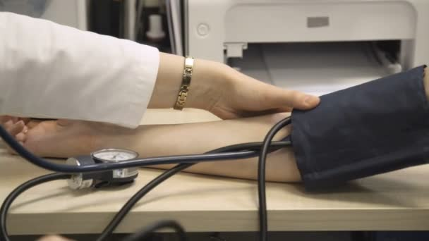 Doctor measures blood pressure of patient