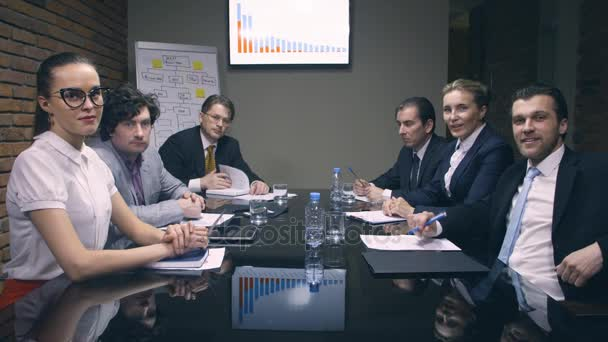 Group of business people looking at boss