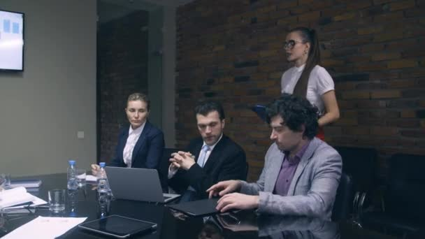 Business lady gives colleagues folders with documents