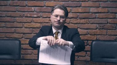 Businessman tearing a contract in pieces