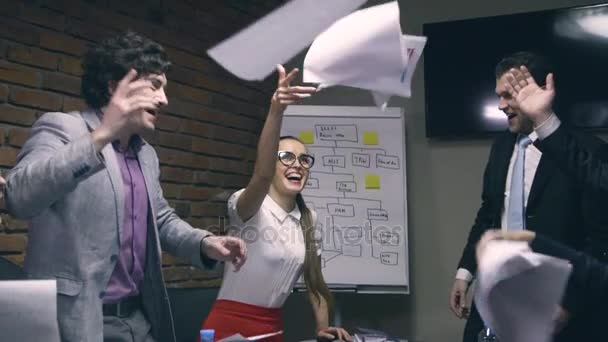 Super slow motion. Business people throw papers into air
