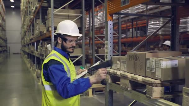 Man checking cargo on shelves with scanner
