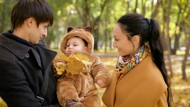 Playful baby with parents in the forest.