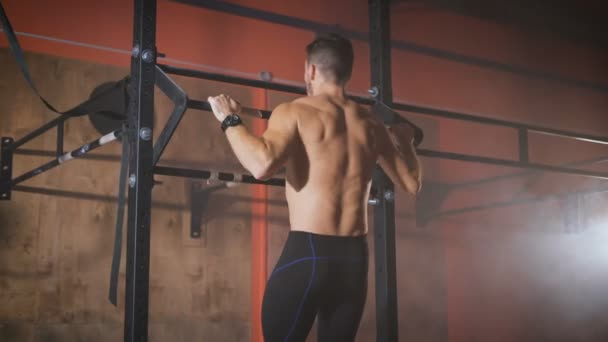 Strong man doing pull ups.