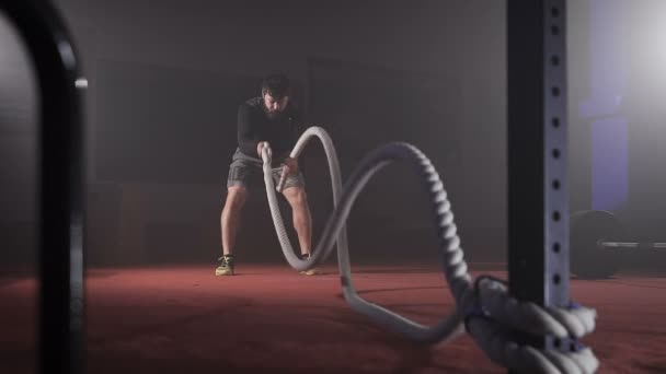 Adult athlete doing exercise with rope.