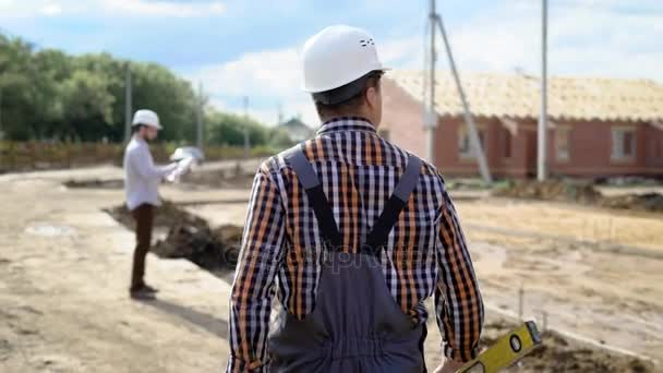 Anonymous man holding tool while working on site in summer