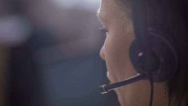 Crop shot of woman using headphones working as support center assistant
