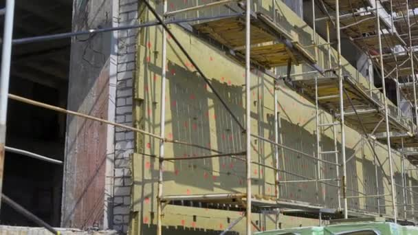 Scaffolding on a construction site in daylight.
