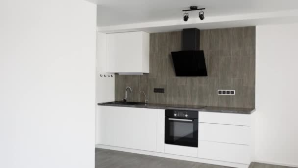 camera is moving inside a new repaired kitchen room in modern apartment, trendy design