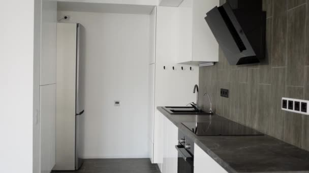 Overview on new luxury new kitchen in scandinavian style in apartment.
