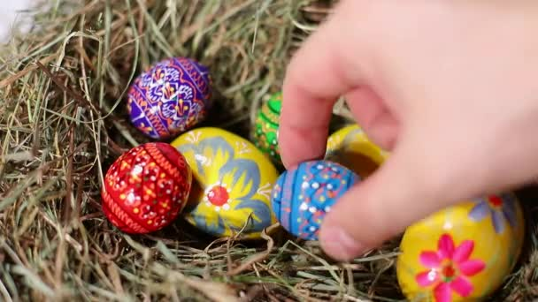 Closeup of colorful Easter eggs lie in the nest