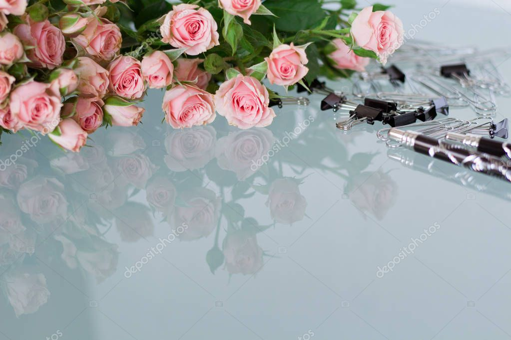 Office table with pink roses