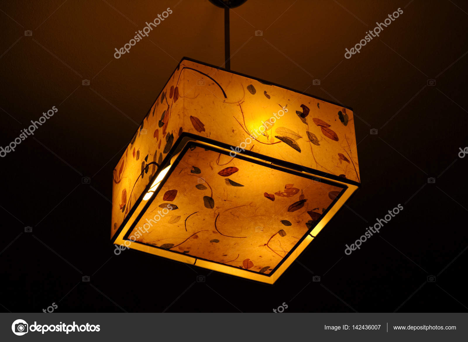 Hanging plastic square ceiling lamp with a yellow dim light — Stock