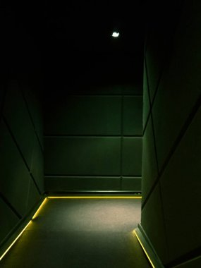 Corner of a dimmed empty corridor of a building