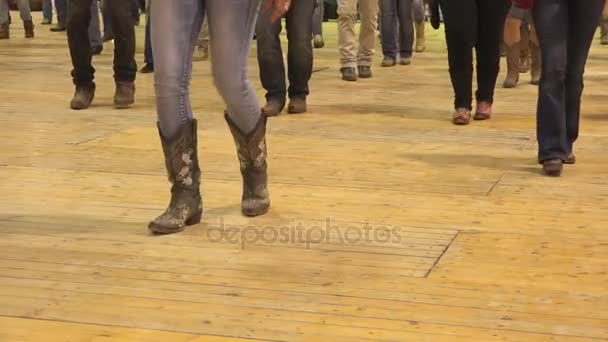 c60bd2f4590 Woman legs dancing cowboy line dance at a folk country event, USA ...