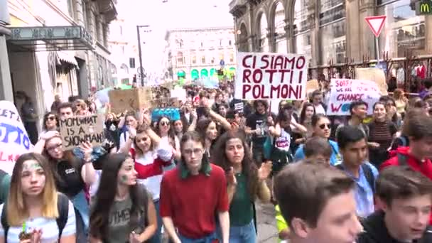 MILAN, ITALY - MAY 24, 2019: Environmentalists demonstration of students walking at global strike for climate march. People with picket signs, crowd at Friday for future, picketers at ecologist parade