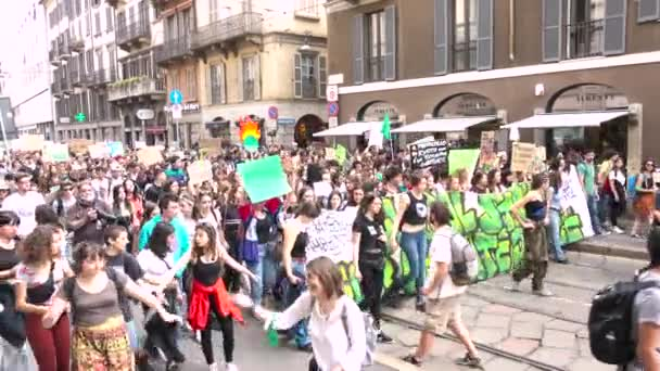 MILAN, ITALY - MAY 24, 2019 Students walking at global strike for climate demonstration. Crowd of picketers at environmentalists march, activists people with banner at Friday for future parade