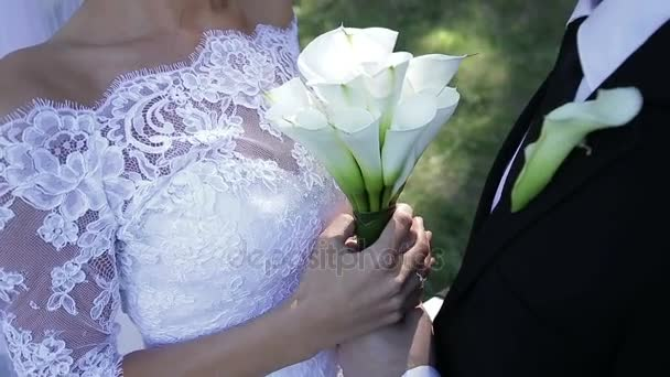 Groom holding brides hands with love