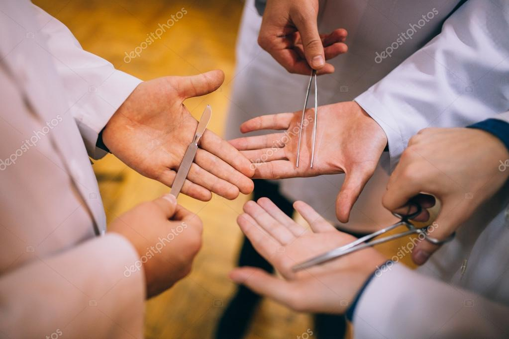 Surgical instruments in human hands