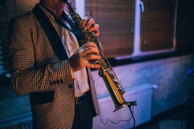 Artist playing on clarinet