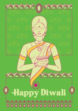 India Lady holiding Diwali decorated diya for light festival of India