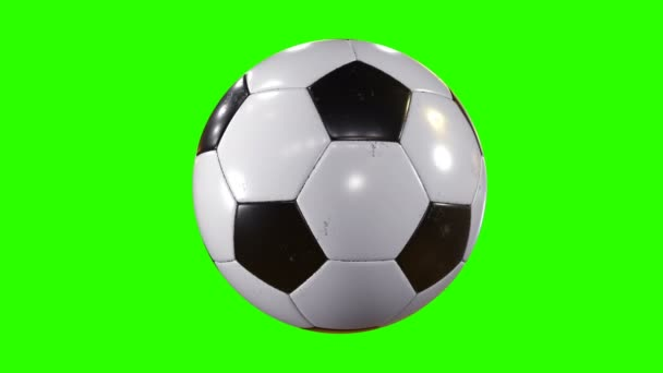 Sada 3 videa. Krásný fotbalový míč rotující v pomalém pohybu na zelené obrazovce. Tvořili fotbalové 3d animace otáčení koule. 4 k Ultra Hd 3840 x 2160.