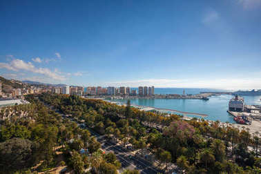 aerial view of park and marina from above Malaga city