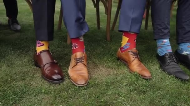 Several men in business suits, but with funny colored socks