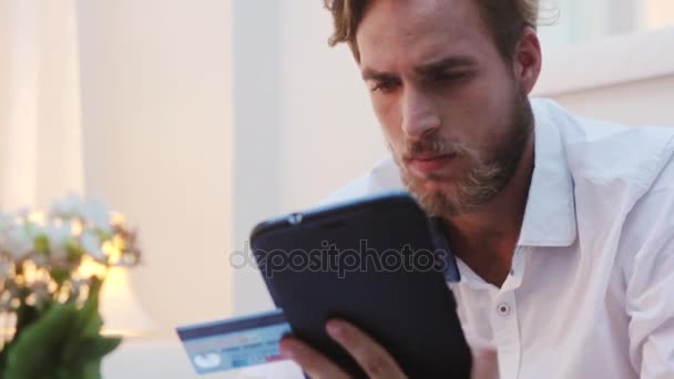 Man shopping online with credit card