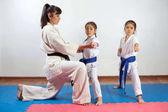 Fotografie Coach woman showing martial art for children