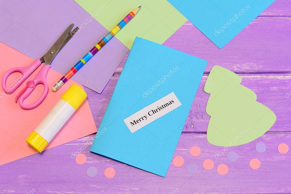 Colored Paper Set, Scissors, Pencil, Glue Stick, Christmas Tree And Balls  Cut From Paper, Paper Piece With Words Merry Christmas.  Colored Writing Paper