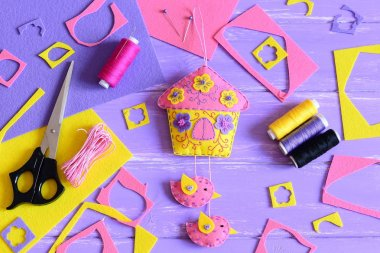 Easy wall decoration make of felt. Handcraft supplies on a wooden table. Spring or summer crafts idea for children and adults. Creative DIY to decorate room. Do it yourself decorating idea. Top view