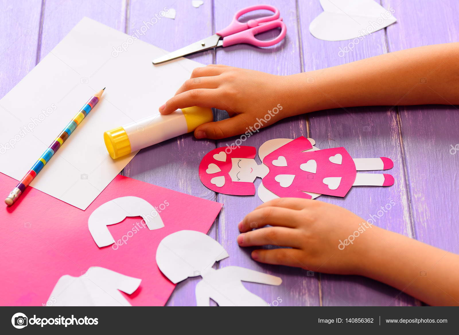 Small Child Made An Angel Doll Of Cardboard Childrens Hands On A Wooden Table