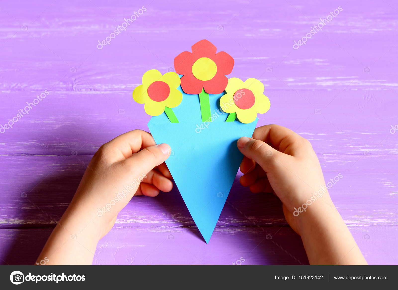 Small child made paper flowers crafts for mothers day or birthday small child made paper flowers crafts for mothers day or birthday child holds and shows mightylinksfo