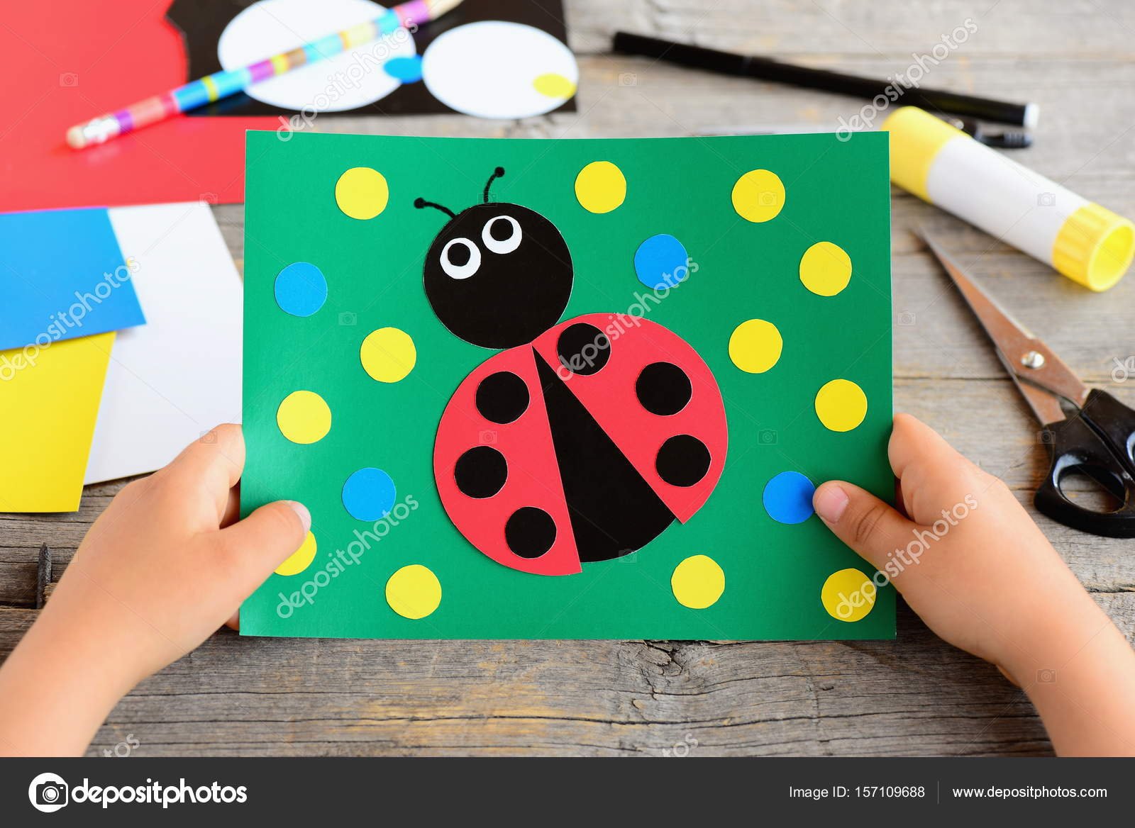Small Child Holds A Ladybug Card In His Hands Created Cardboard Stationery On Desk Circle Crafts For Teaching Kids To