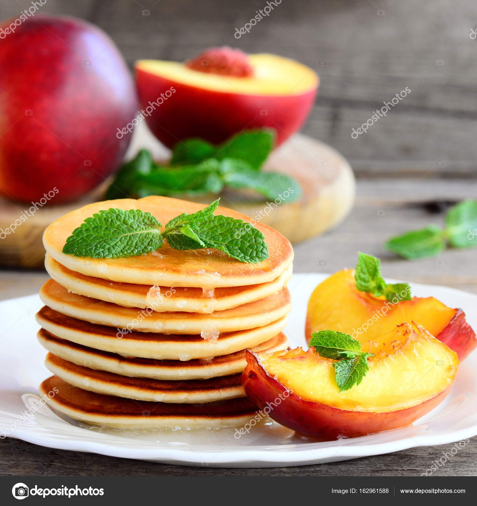 Yummy pancakes with sirup nectarine and mint on a plate easy fried pancakes stack fried pancakes recipe homemade pancakes recipe homemade pancakes photo delicious pancakes idea pancakes with fruit ccuart Images