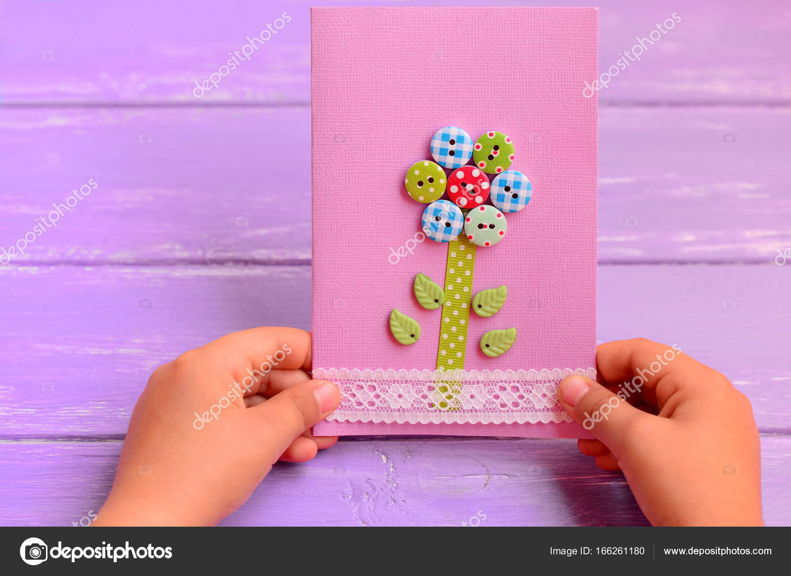 Child holds a flower card in his hands child made a greeting card mothers day cards to make in school homemade mothers day card idea mothers day cards ideas for preschool mothers day cards handmade easy m4hsunfo