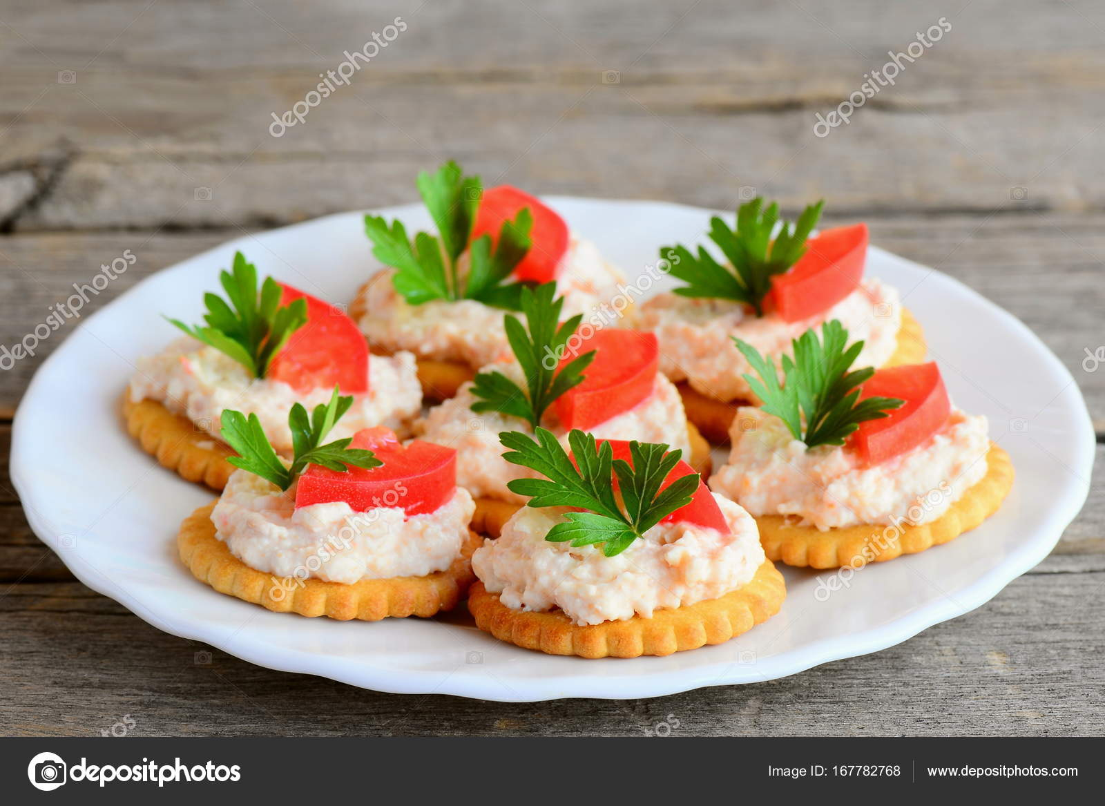 Salty crackers with cream cheese on a serving plate. Simple snack from salted crackers & Salty crackers with cream cheese on a serving plate. Simple snack ...