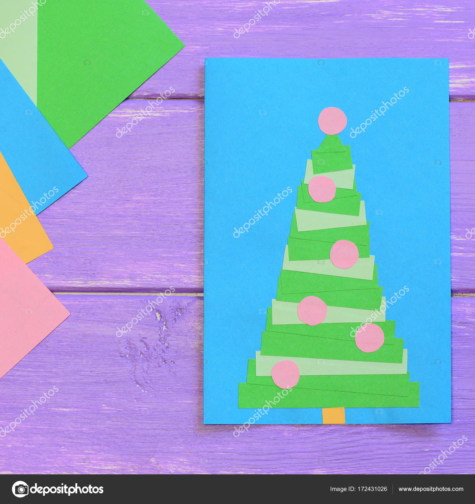Merry christmas card colored paper sheets on purple wooden table making christmas card christmas card ideas for toddlers childrens christmas cards creating christmas card simple greeting card design m4hsunfo