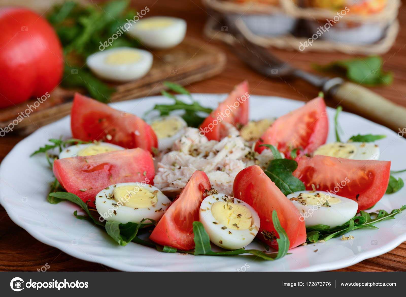 Simple Vegetable Salad With Chicken And Eggs Healthy Salad With Fresh Tomatoes Slices Arugula Boiled Quail Eggs Chicken Fillet And Spices On A White Plate Rustic Style Closeup Stock Photo Image