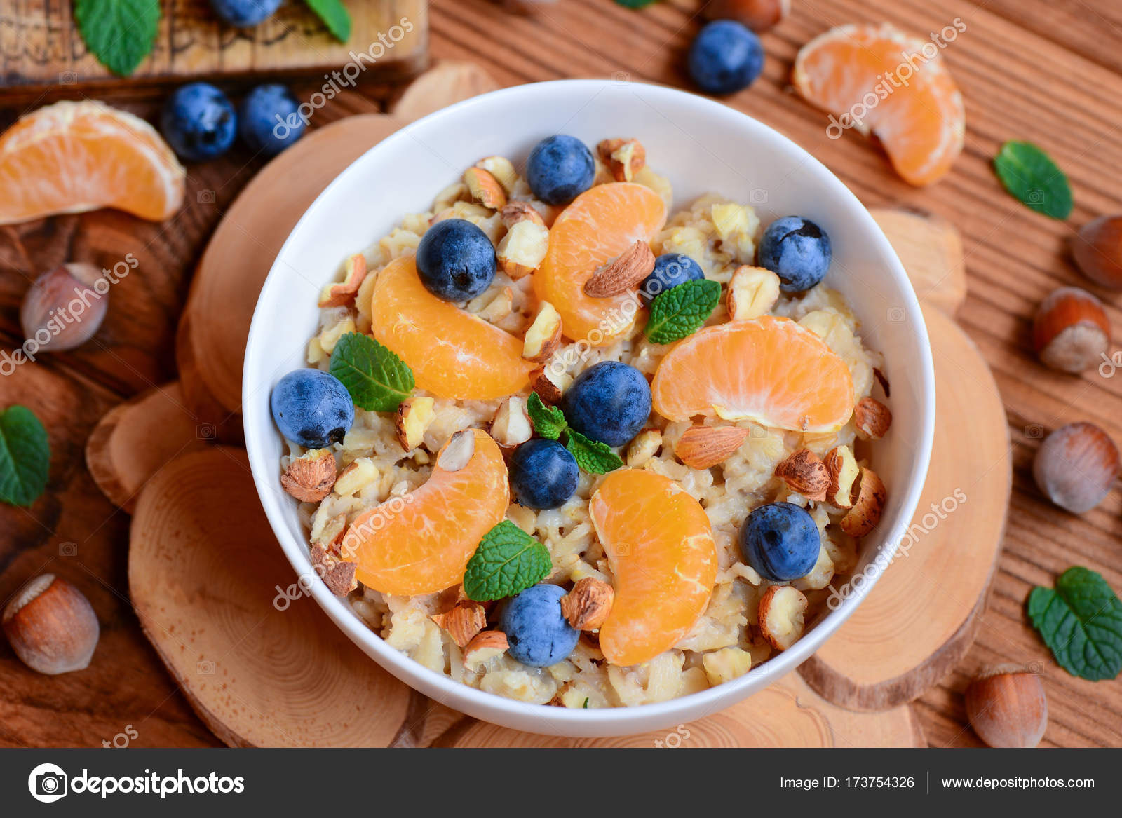 Oats porridge with berries and nuts. Homemade porridge with fresh ...