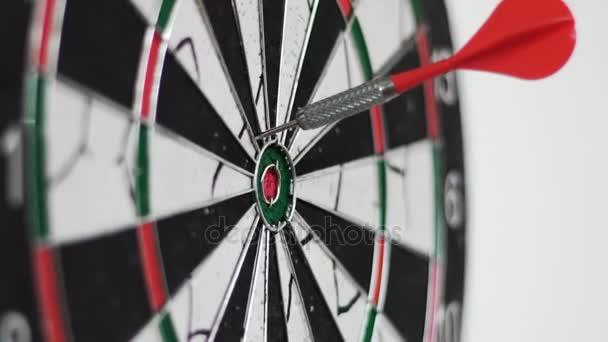 Darts Being Thrown Into Dartboard